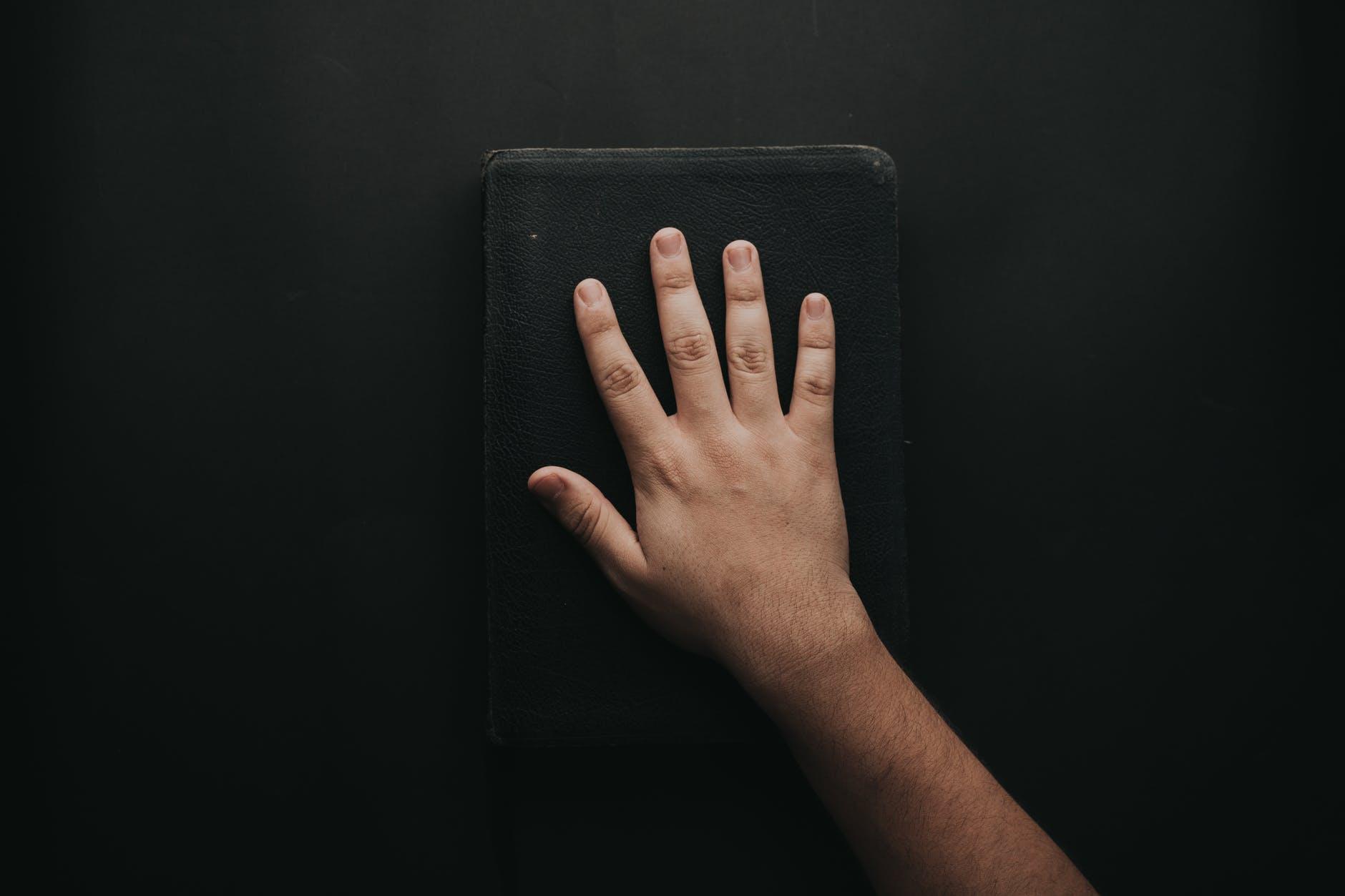 man touching book